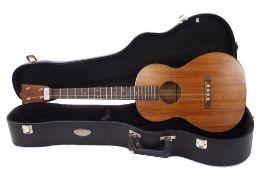 1970s C.F. Martin & Co Style 1 all Koa baritone ukulele, within a contemporary CNB hard case