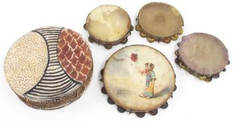 Four interesting early tambourines each with hand decorated rims, one with painted skin depicting an