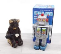 Vintage Japanese automaton bear, seated on a tin trunk pouring from a bottle, bearing Alps and VIA