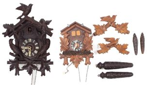 """Black Forest two train cuckoo clock, the 4.75"""" dial within a chalet case applied with carved birds"""
