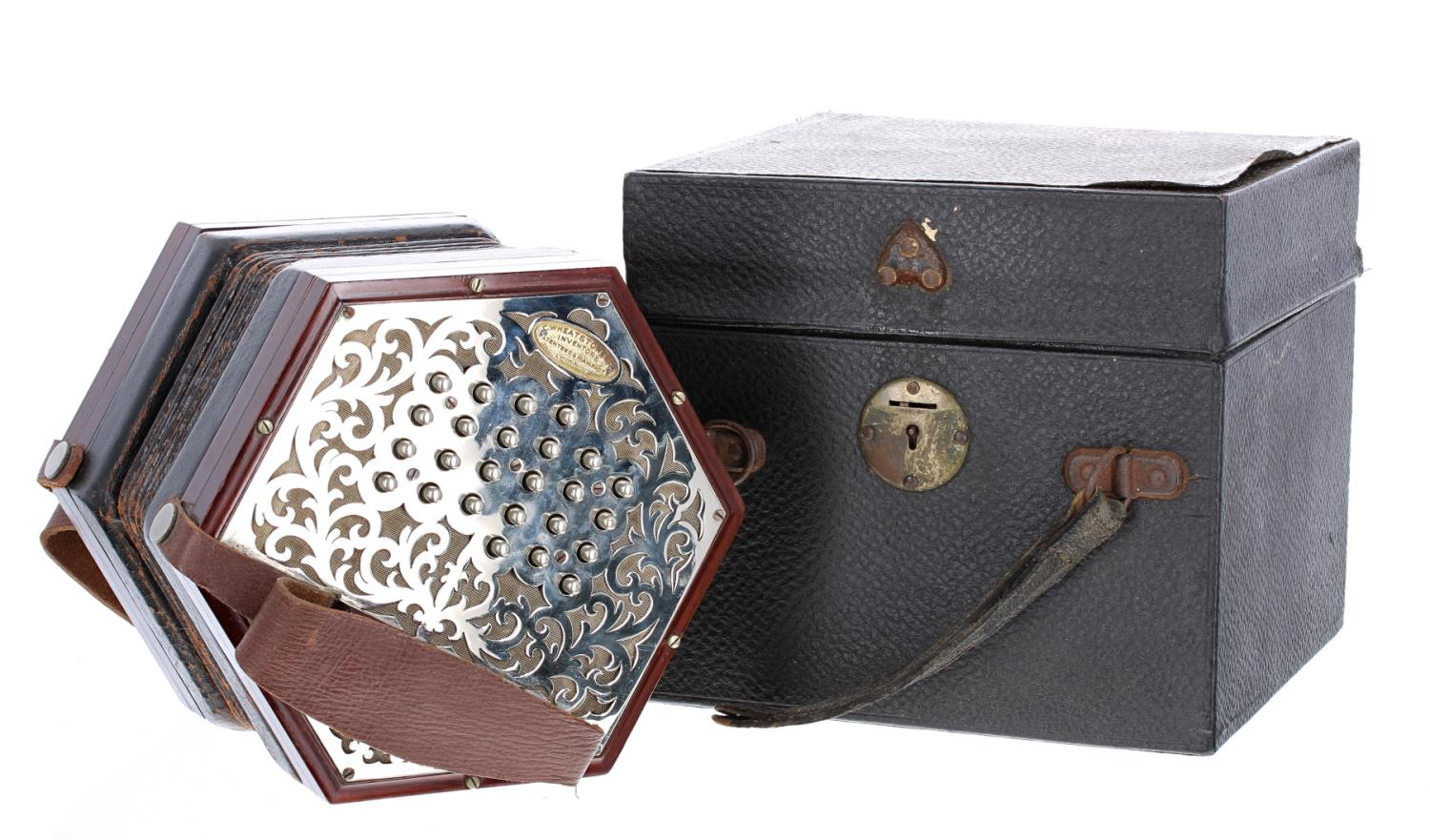 Good Wheatstone duet concertina with forty-six metal buttons on pierced foliate metal ends, six-fold