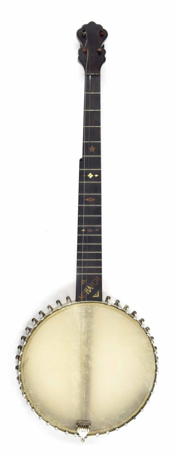 Monarch five string open back banjo circa 1900, with missing Mother of Pearl geometric inlay to