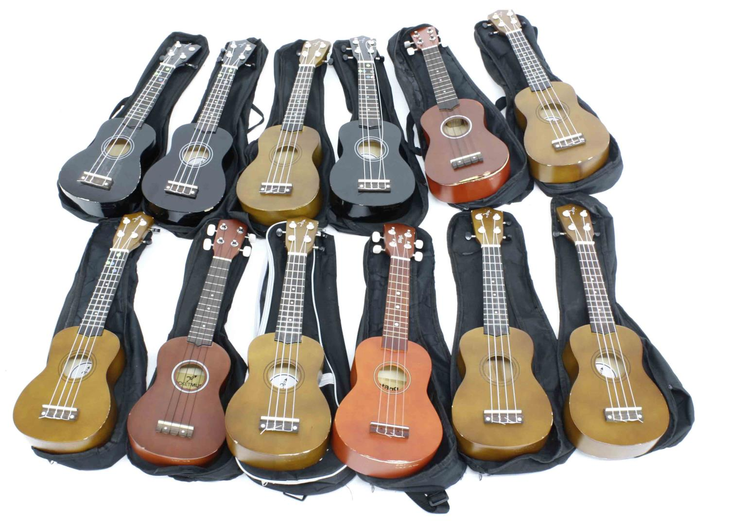Twelve contemporary ex-student played ukuleles in variable condition, all in soft bags (12) *This