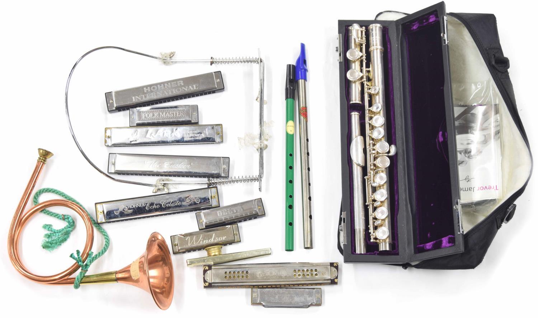 Trevor James 10XIII metal flute, case; together with nine various harmonicas, a harmonica neck