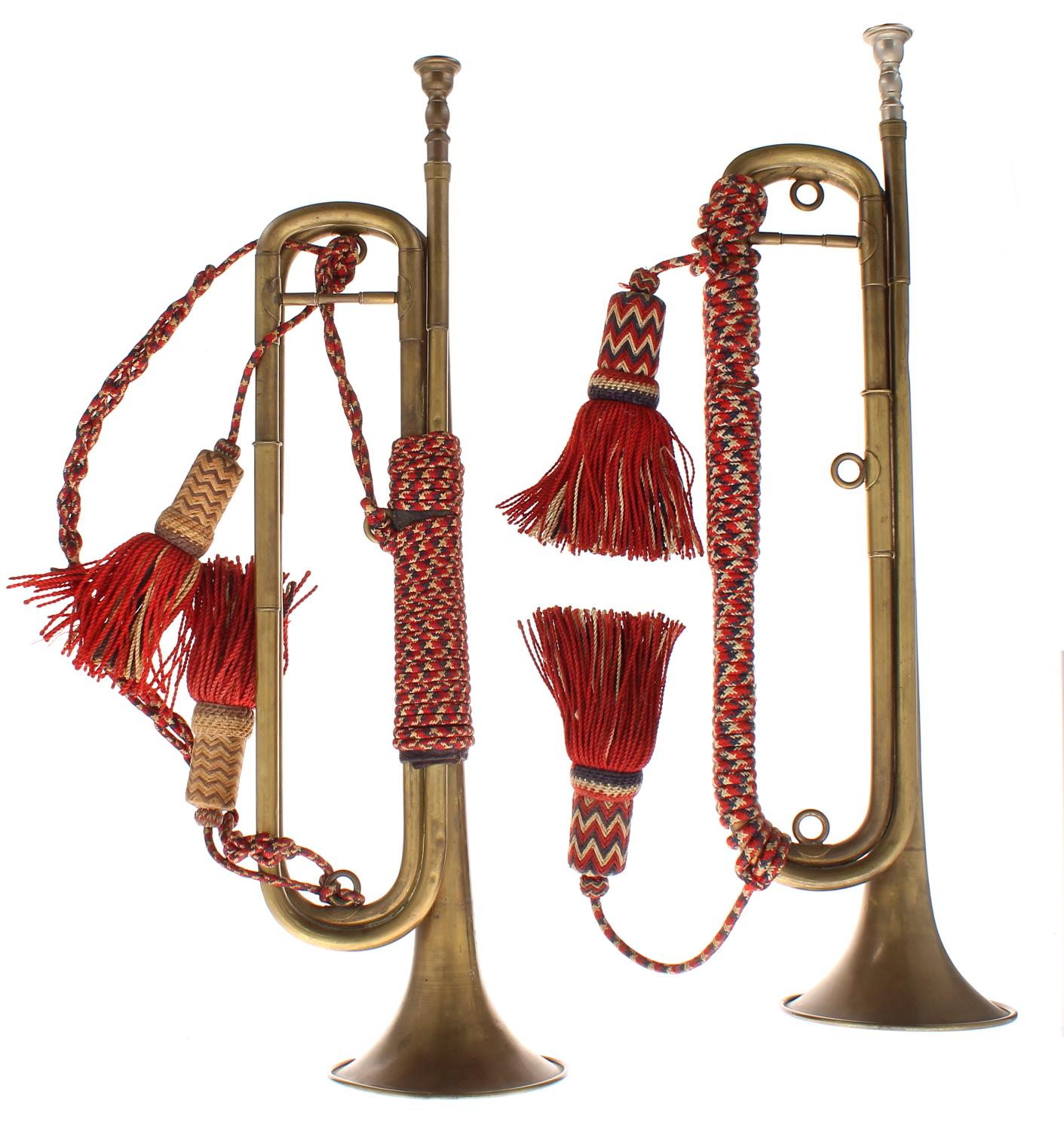Pair of cavalry trumpets by and stamped Couesnon, Paris, brass tubing coiled twice, bound with