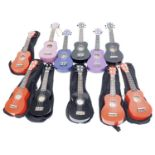 Eleven contemporary ex-student played ukuleles in variable condition, some cased (11) *This lot is