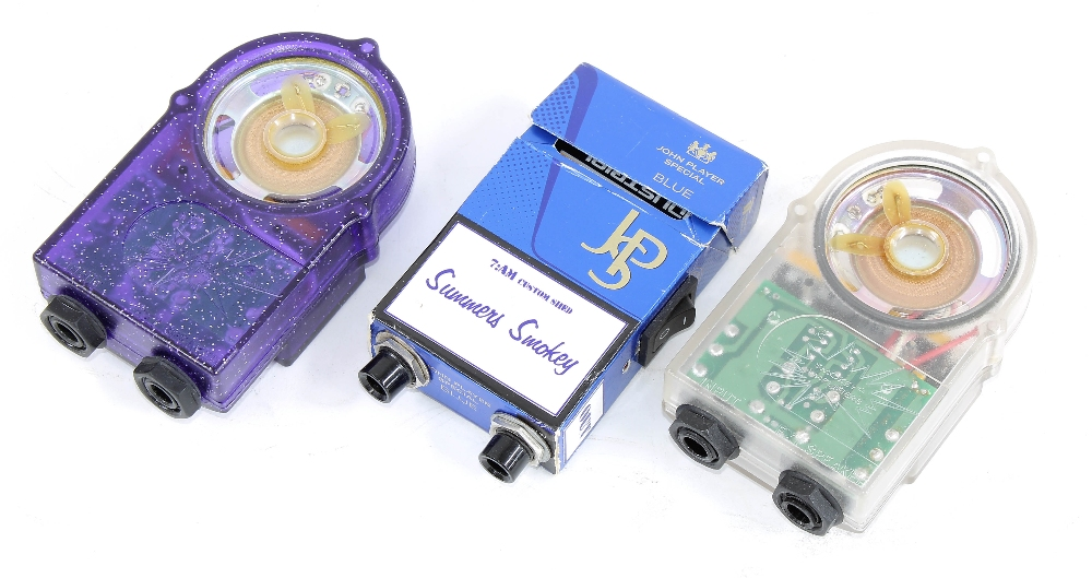 Three 7:AM Smokey 1 watt battery amplifiers, one custom example built within a cigarette packet (3)