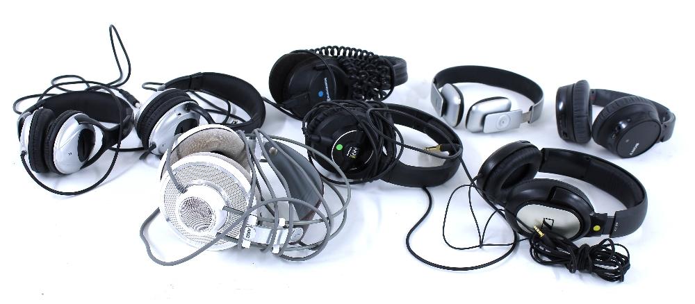 Eight various audio headphones to include AKG K701, KRK KNS-8400, Sony WH-CH700N, Sennheiser