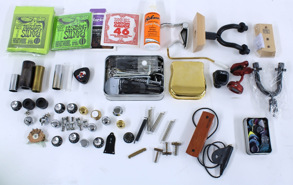 Selection of guitar spares and accessories including strings, knobs, saddles, slides, capos,