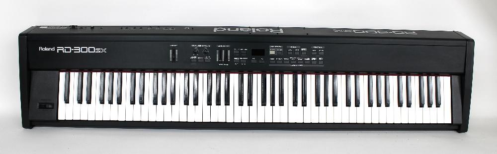 Roland RD-300SX digital piano, made in Japan, ser. no. ZU58626, with Rock Sack gig bag