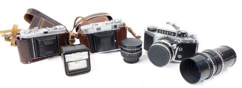 Exacta VX1000 camera, with Carl Zeiss Jena Tessar 3.8/50 lens and additional Meyer Optik Görlitz 3.