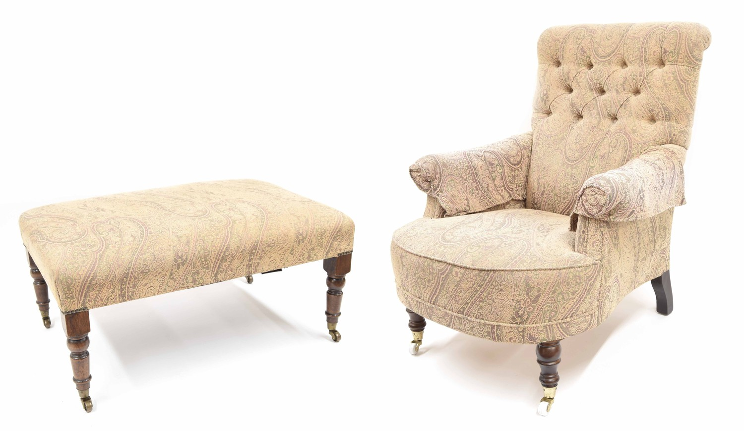 Victorian style button-back upholstered armchair, with a pale paisley style design upholstery upon