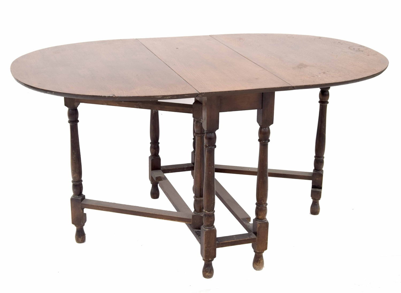 "Oak oval gateleg table, 58"" wide extended, 35.5"" deep, 30"" high"