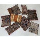 Eight Kelim type covered cushions