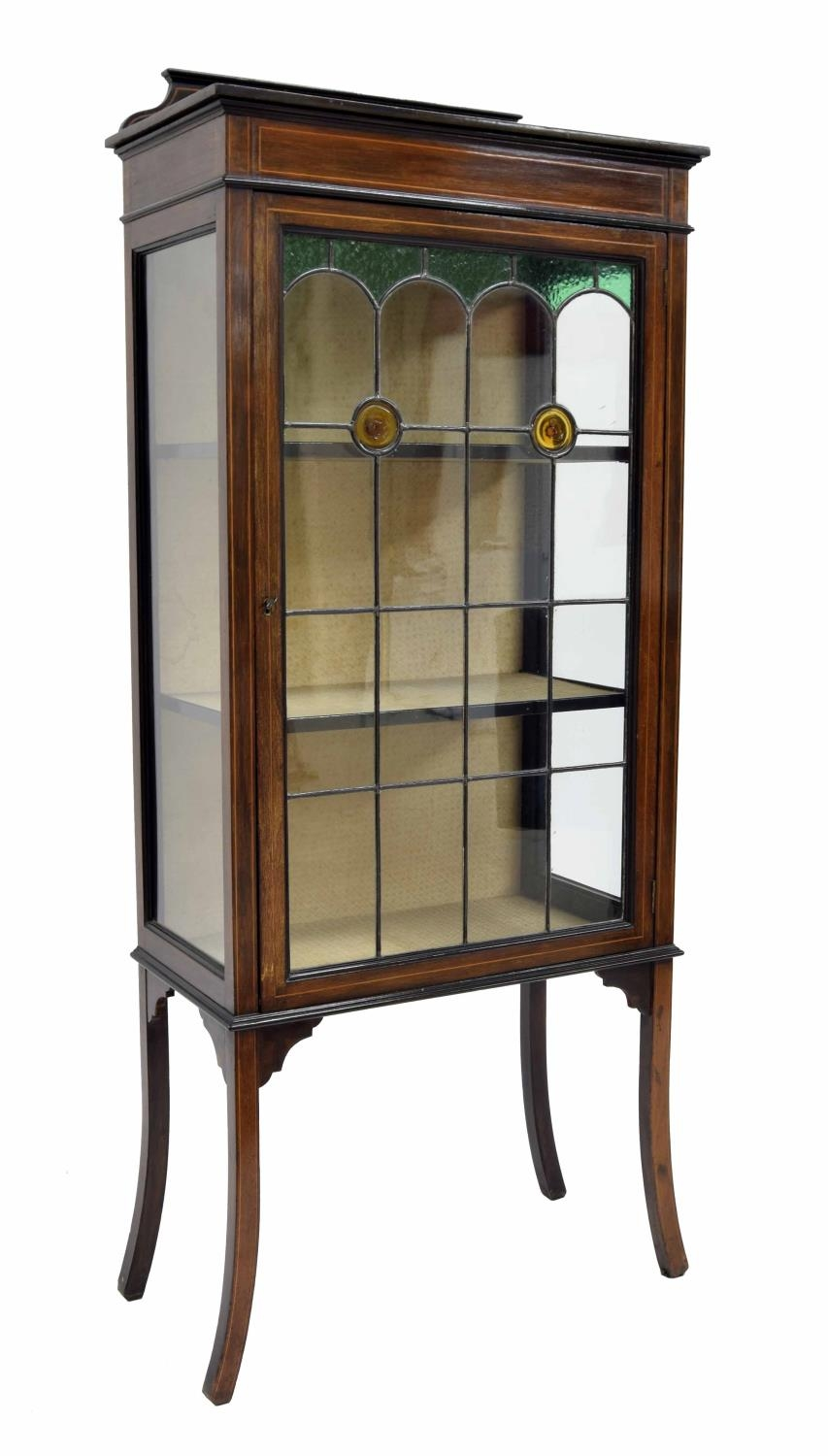 Edwardian mahogany inlaid display cabinet, with a single leaded stained glass door enclosing fixed