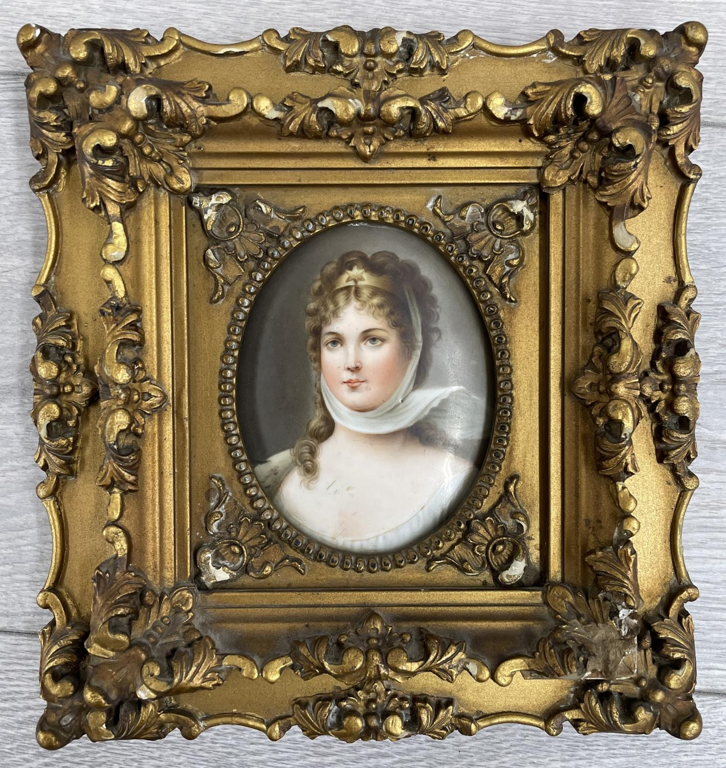 ContinentalSchool (20th century) - portrait of an elegantly dressed young lady, a painted plaque,