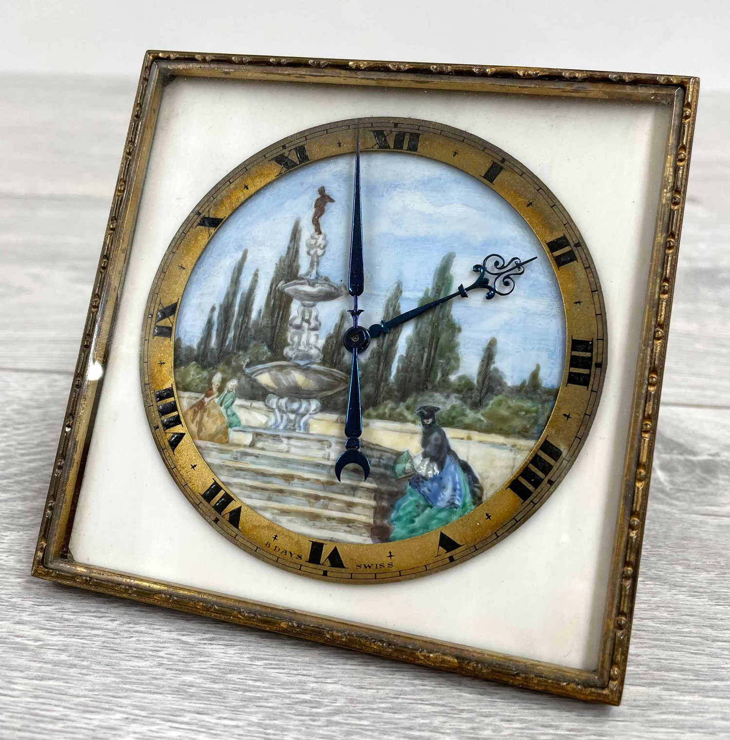 Good quality Swiss 8 Day easel square clock timepiece, with a painted dial depicting figures at a - Image 2 of 4