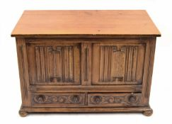 18th century style small oak coffer, the hinged top over a carved linen fold panelled front and