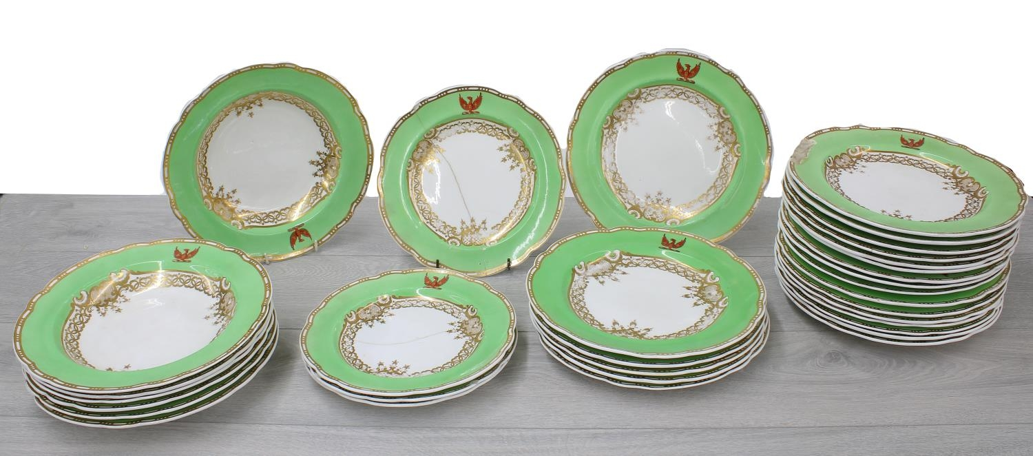 Spode Felspar porcelain part dinner service, with green and gilded borders decorated with an eagle
