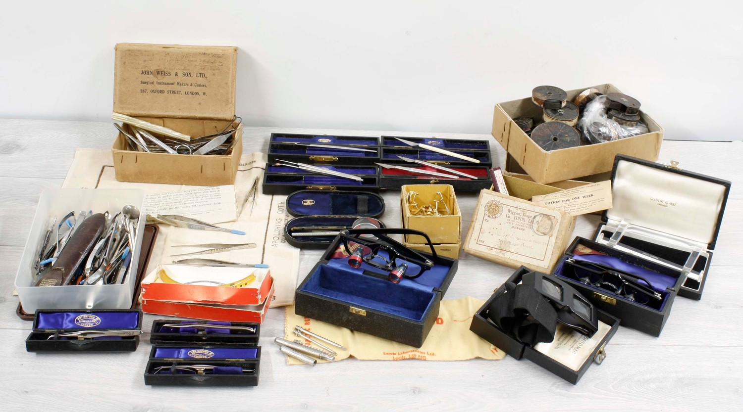 Collection of assorted opticians/medical instruments and apparatus including magnifying glasses,