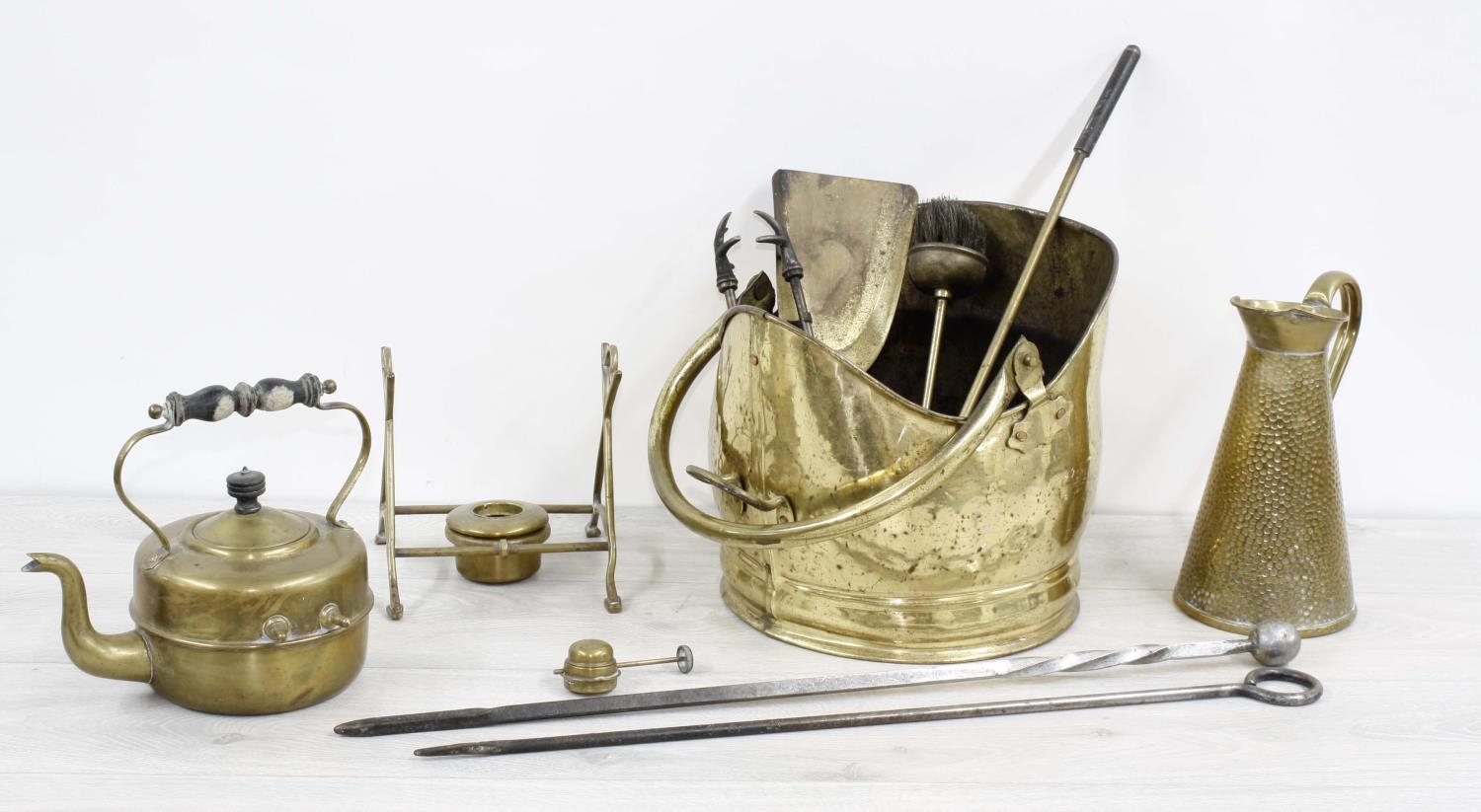 """Brass coal helmetwith swing handle, 15"""" high; together with selected fireside tools, spirit"""