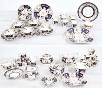 Attractive early 19th century English porcelain tea service painted with flowers within blue and