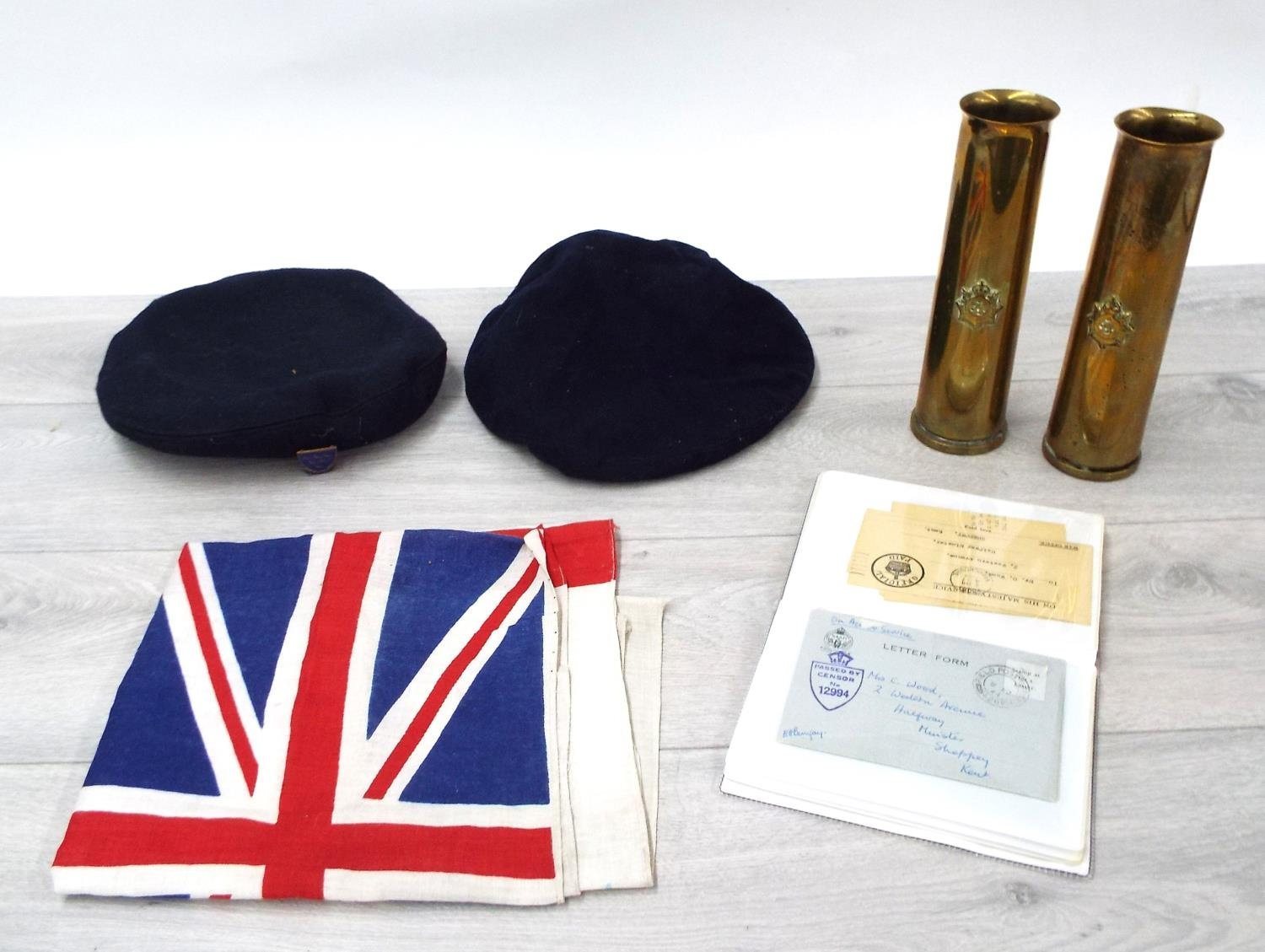 """Pairof brass gun shell 'trench art' vases, 8.5"""" high; Union Flag, two Naval berets, one applied"""