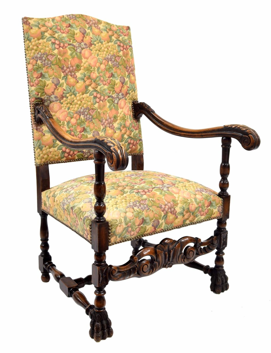 Carolean style upholstered throne armchair, the padded back and stuffover seat with modern