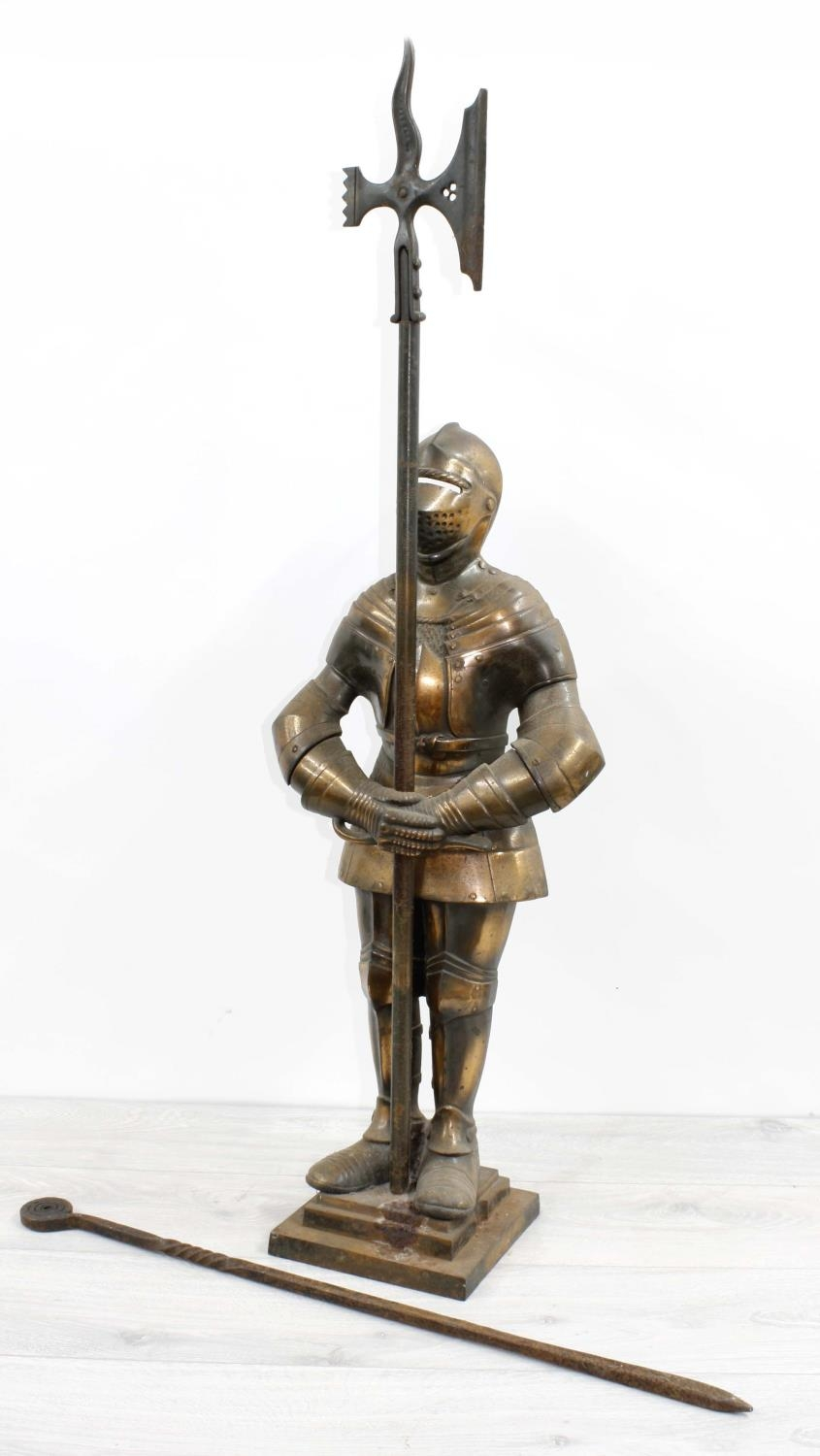 Nestor fireside companion modelled as a suit of armour,stamped and registration numbers to the
