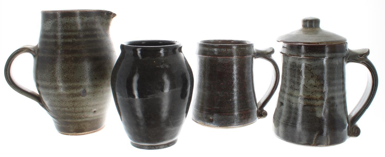 "St Ives studio glazed stoneware jug and two tankards, impressed marks, the jug 6.75"" high;"