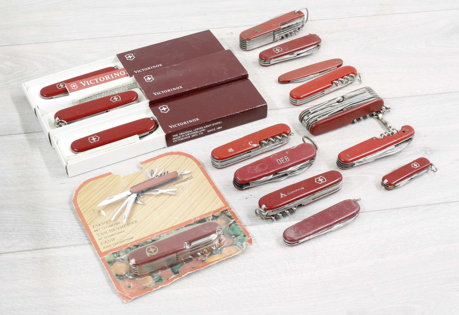 Collection of folding penknives including boxed Victorinox examplesand similar Swiss type penknives