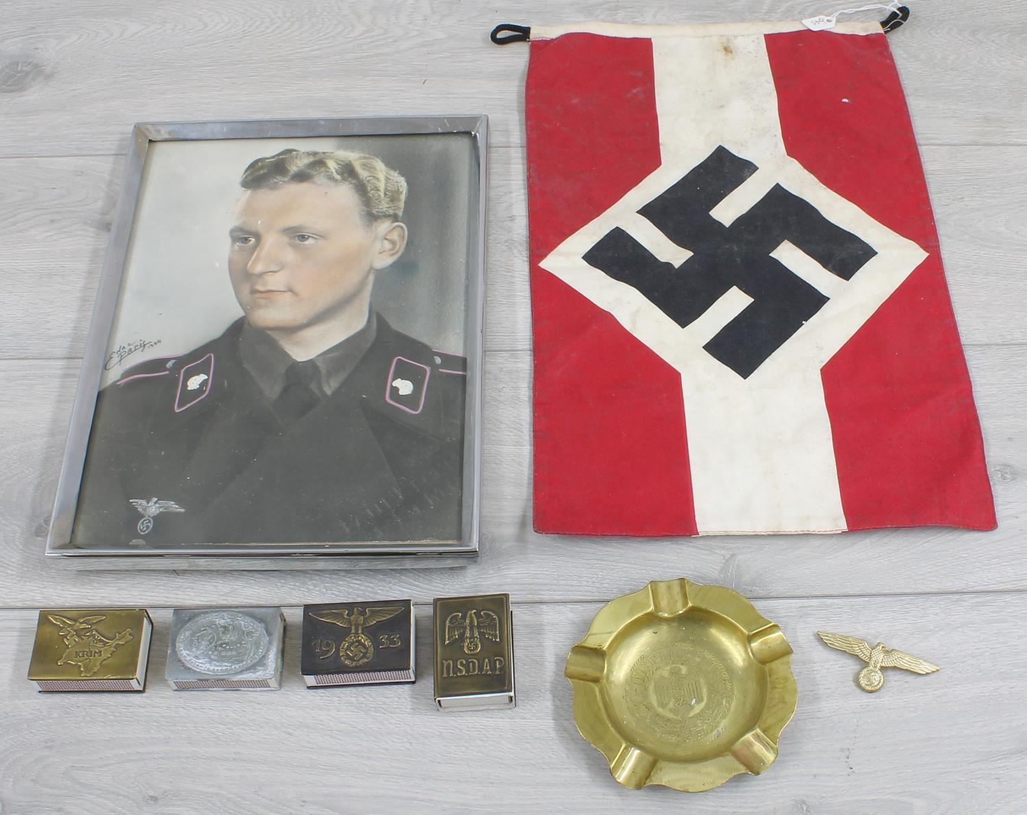 """Small Nazi Party flag,measuring 15"""" x 9.5""""; together with brass ashtray engraved with The Nazi"""