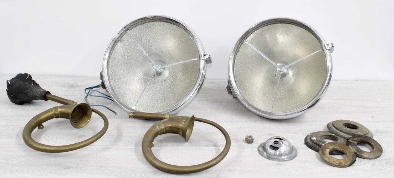 "Pair of Joseph Lucas LtdP100Lchrome cased automobile headlamps (pitting to chrome) 12"" diameter;"
