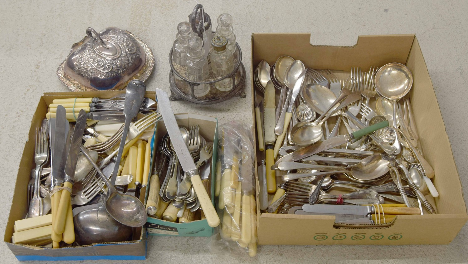 Collection of assorted vintage flatware including stainless and plated; together with a vintage