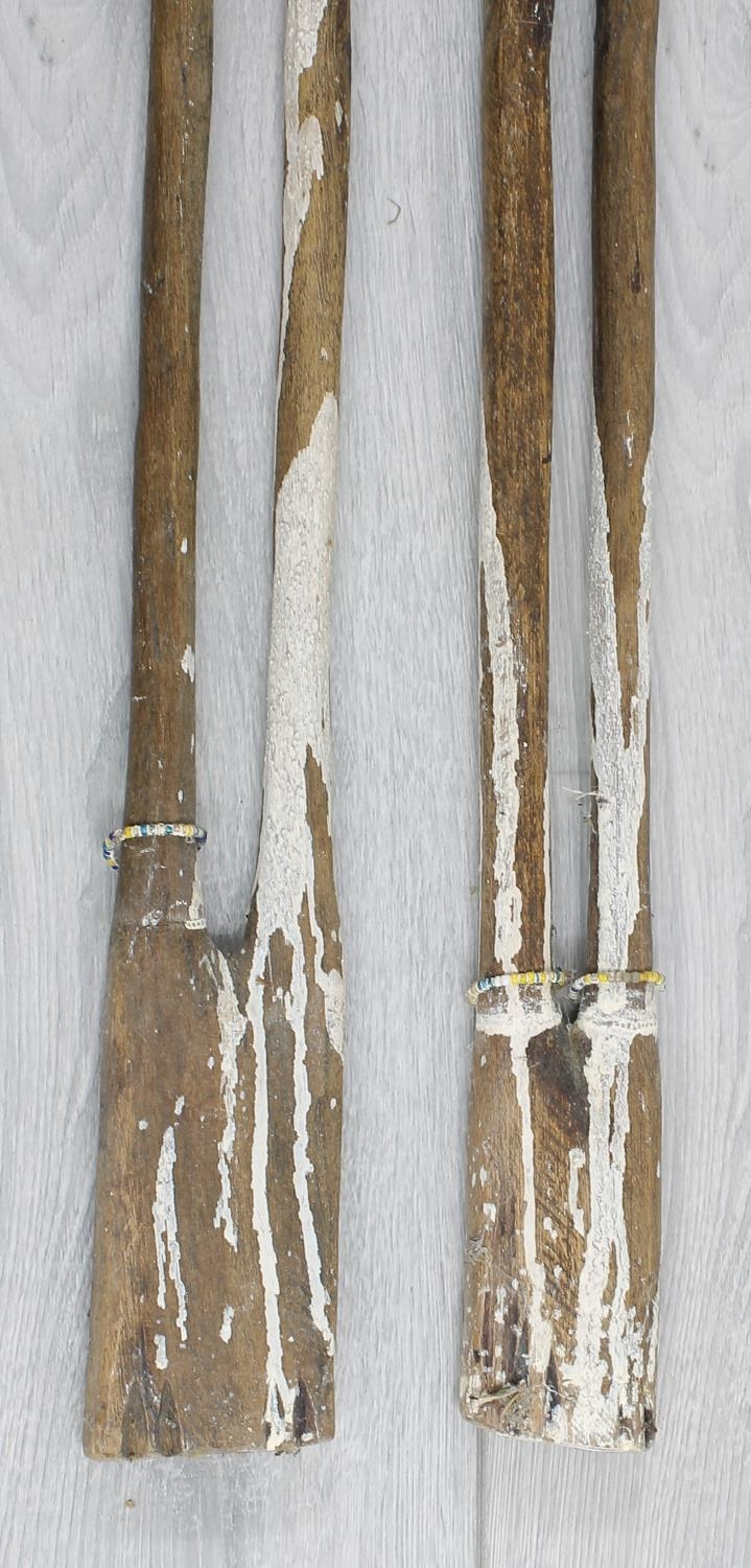 Two similar interesting African tribal wooden staffs, each surmounted with carved bead set heads, - Image 3 of 3