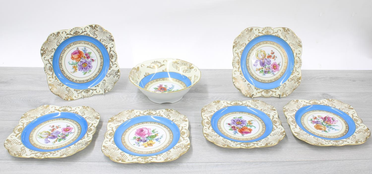 Victoria Czechoslovakian porcelain dessert service, decorated with flowers within blue and gilded