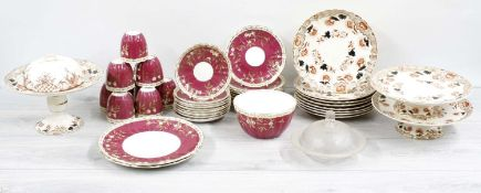 19th century porcelain part tea service, with gilt floral sprays and highlights on a purple