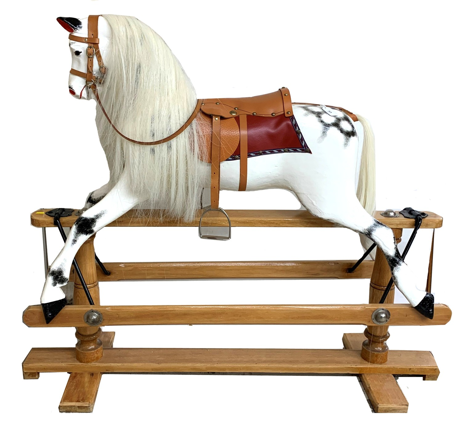 """Good Lines Brothers Ltd rocking horse with leather saddle and reins stamped LB Ltd SP2, 52"""" wide,"""