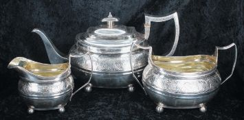 """George III three piece boat shaped silver tea set, comprising teapot 6"""" high, twin-handled sucrier"""