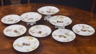 A. Lanternier Limoges porcelain dessert service, enamelled with birds upon gilded branches,