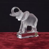 Lalique moulded clear and frosted glass model of an elephant, with a raised trunk upon a plinth