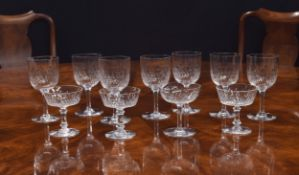 French suite of drinking glasses, possibly Baccarat, with bubble effect decoration comprising,seven