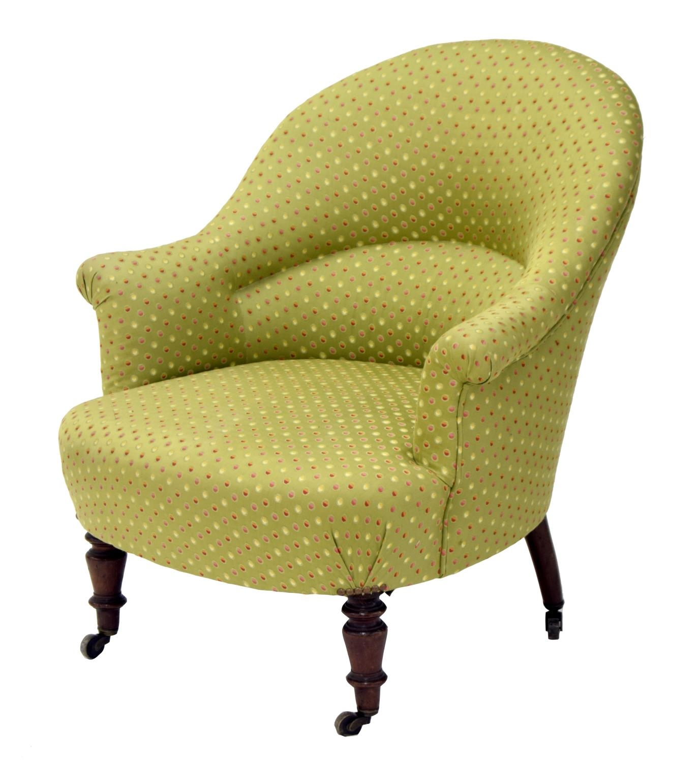 Victorian green polka dot upholstered bedroom armchair, the bowed seat upon short turned feet,