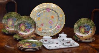 Twelve Porcelain de Limoges side plates,decorated with still life of fruit, an A.J. Heritage