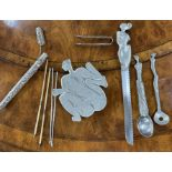 """Carrol Boyes - pewter nude figural trivet, 7"""" x 6"""", signed to the underside; together with Carrol"""