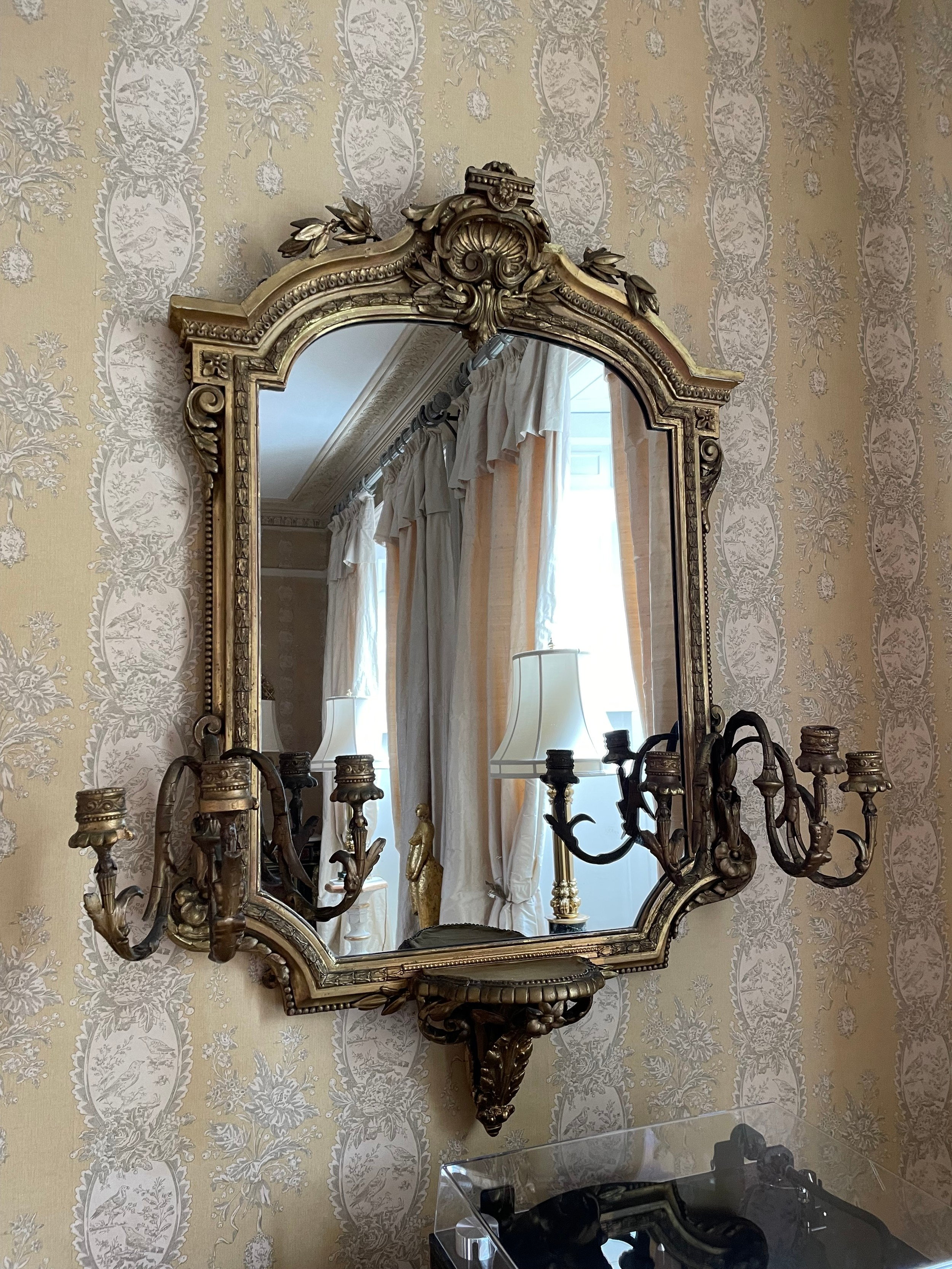 Good 19th century giltwood and gesso girandole mirror, the arch top moulded frame with a shell
