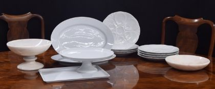 """Set of eight Porcelain de Limoges oysterplates, 10.5"""" diameter; with further Limoges white"""