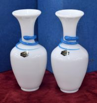 """Pair of Saint-Louis opaque glass snakes vases with blue trail decoration, signed, 8"""" high; each with"""