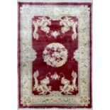"""Chinese silk dragon design red ground rug, 73"""" x 48"""" approx"""