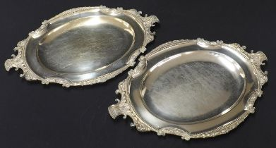 Pair of Elkington silver plated oval meat serving plates, with cast foliate and sheep head mounts